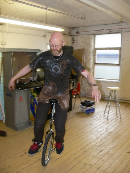 File:Unicycling-in-chainmail-on-open-day-2011.jpg